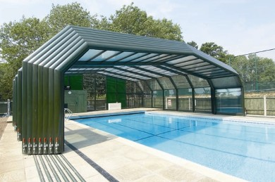 Advantages of a retractable pool fence home fence solutions Retractable swimming pool enclosures